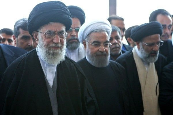 Ali_Khamenei_and_Hassan_Rouhani_in_funeral_of_Abbas_Vaez-Tabasi