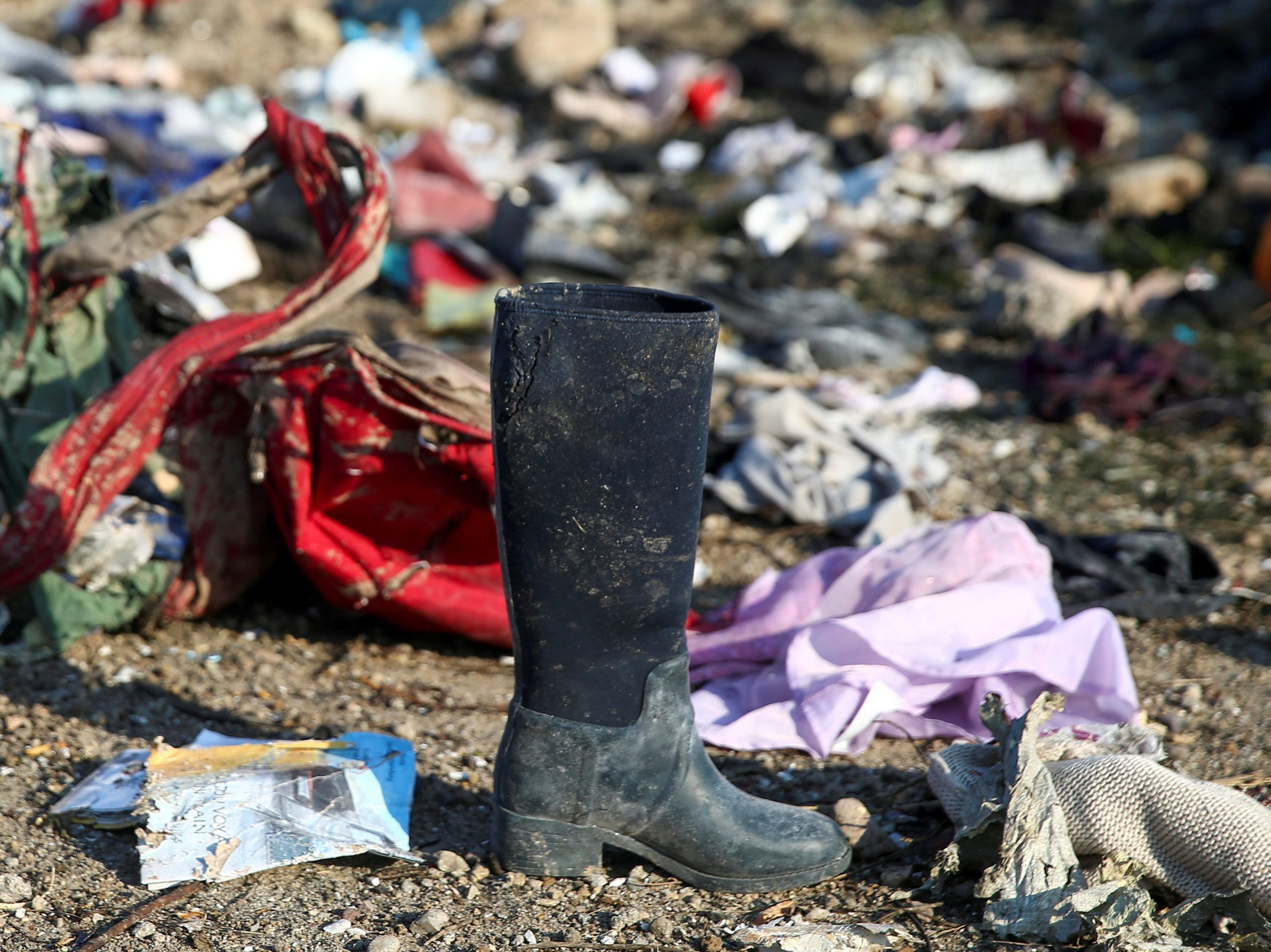 FILE PHOTO: Passengers' belongings are pictured at the site where the Ukraine International Airlines plane crashed after take-off from Iran's Imam Khomeini airport, on the outskirts of Tehran, Iran January 8, 2020. REUTERS./