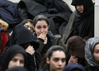 Mourners Attend a Vigil at University of Toronto