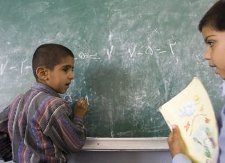 Iranian students study in a classroom in Bam