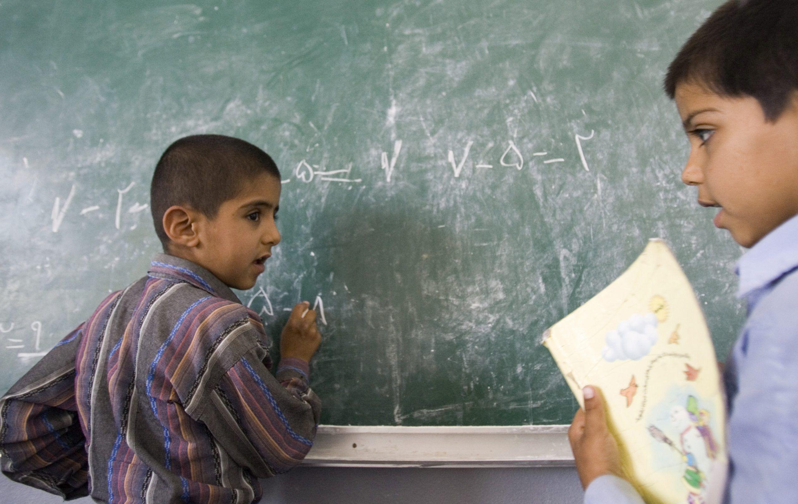 FILE PHOTO: Iranian students study in a classroom in Bam 1,250 km (776 miles) southeast of Tehran REUTERS/Raheb Homavandi