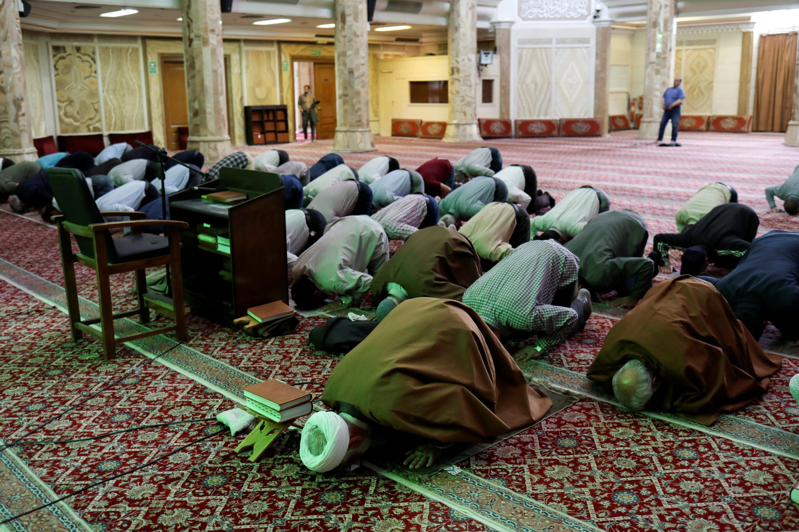 FILE Iranian worshippers pray as they keep social distancing following the outbreak of the coronavirus disease (COVID-19), at a mosque in Tehran, Iran. REUTERS./