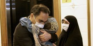 Dr. Sirous Asgari, an Iranian professor who was acquitted in the United States of stealing trade secrets, embraces his family upon his arrival to Iranian Imam Khomeini Airport, amid the outbreak of the coronavirus disease (COVID-19) in Tehran, Iran June 3, 2020.REUTERS./