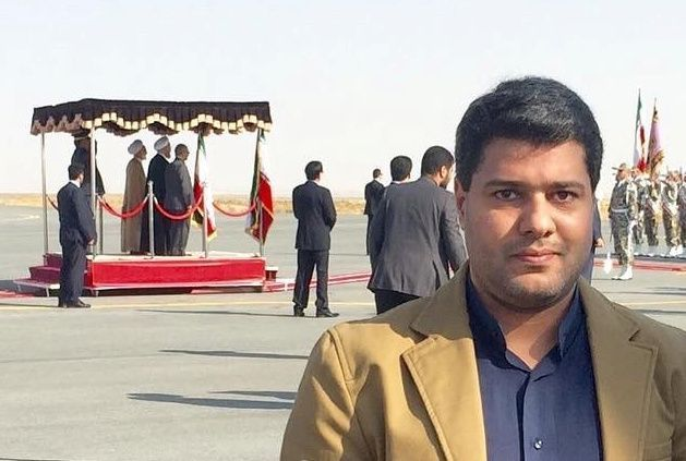 Amir Moghadam poses at Arak airport in Iran, whilst accompanying Iranian President Hassan Rouhani (background) on a provincial trip, in this undated handout photo provided to Reuters on June 11, 2020.