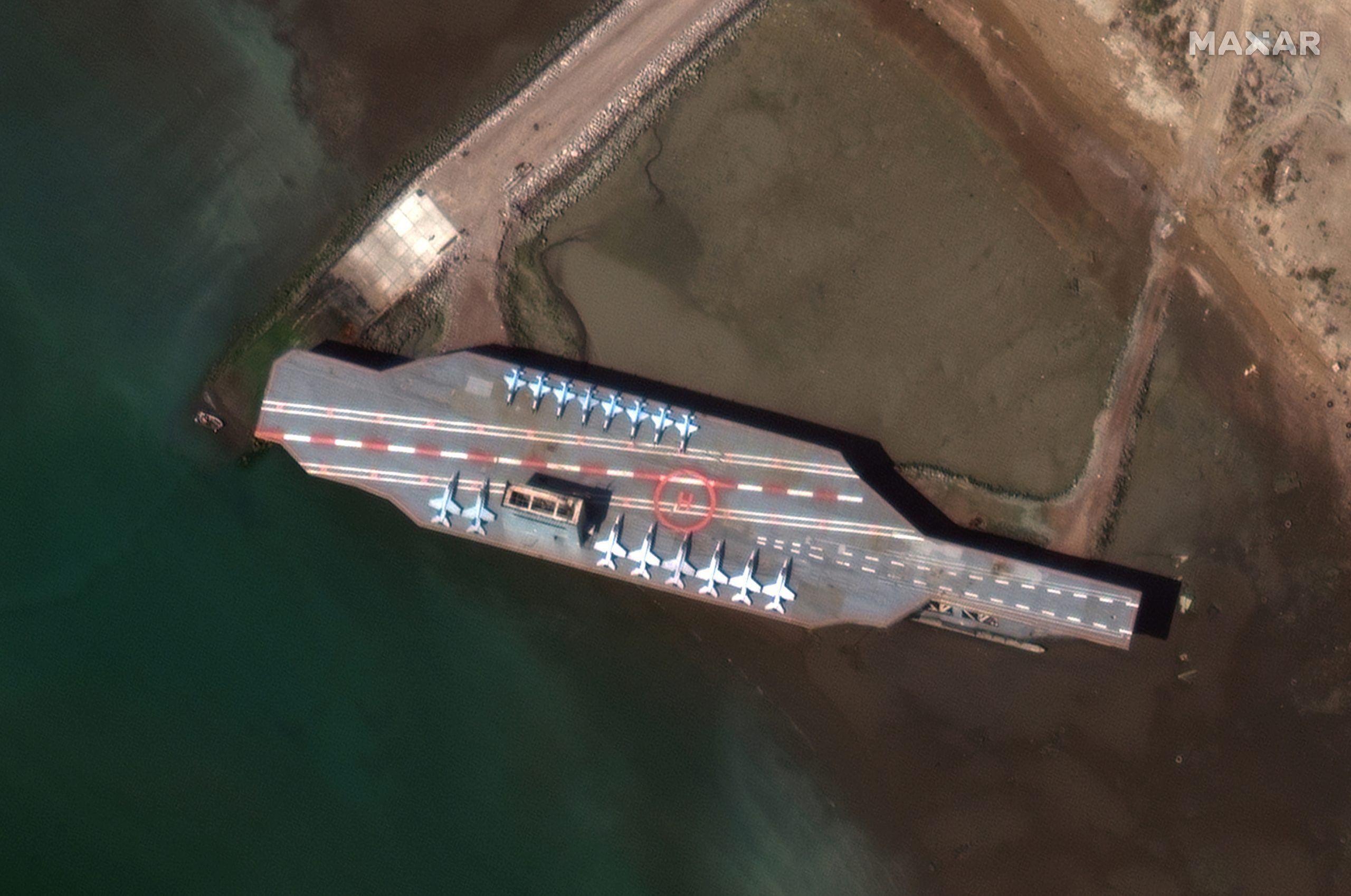 Iran's refurbished mockup aircraft carrier, used previously as a simulated U.S. target during a February, 2015 Iranian naval war games exercise, is seen at its home port of Bandar Abbas, Iran February 15, 2020. Picture taken February 15, 2020.